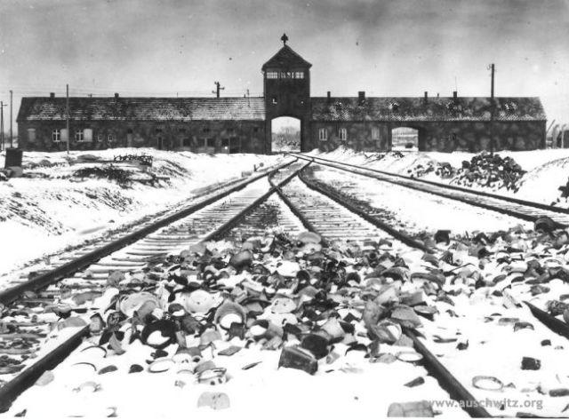 """Photo : The gate in Birkenau Author: Stanisław Mucha The unloading ramp and the main gate called the """"Gate of Death. download"""